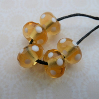 handmade lampwork glass beads, amber and white spots