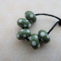 handmade green and white spot lampwork glass beads
