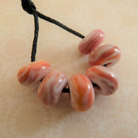handmade orange lampwork glass spacer beads