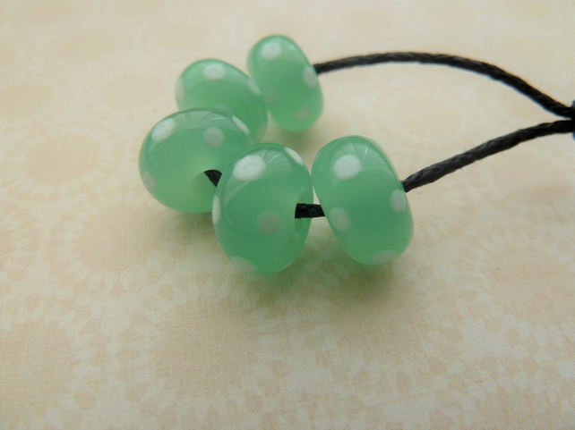 handmade lampwork green and white spot glass beads