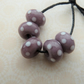 handmade purple and white spot lampwork glass beads
