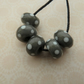 handmade lampwork grey and white spot glass beads