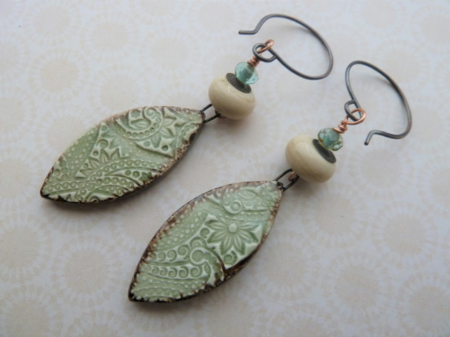 green and ivory lampwork, copper and ceramic earrings
