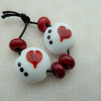 handmade lampwork white and red heart beads