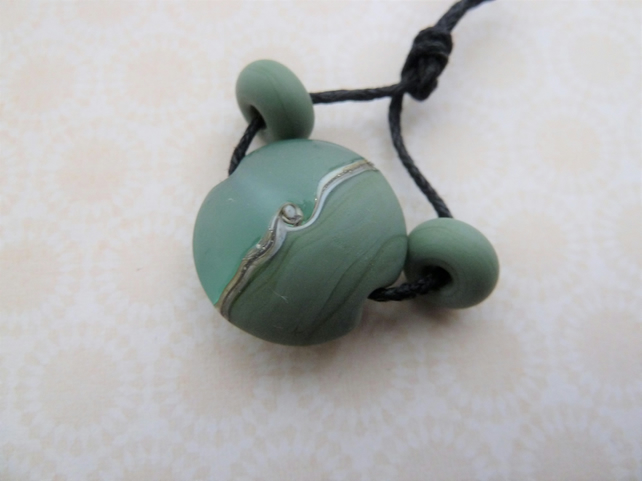 handmade lampwork green glass focal bead
