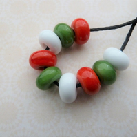 green, red and white lampwork glass spacer beads