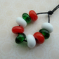 red, green and white lampwork spacer beads