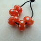 orange and white polka dot lampwork glass beads