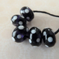 purple and white spot lampwork glass beads