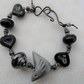grey and black ceramic bird bracelet