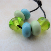 blue and green lampwork glass spacer beads