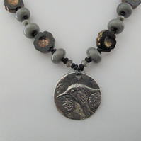 blackbird pewter necklace, grey and black lampwork