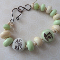 teacup inspirational quote bracelet, green and ivory