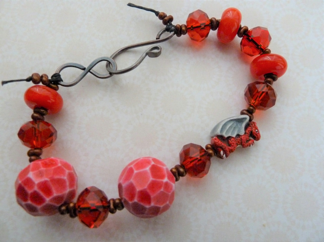 red lampwork, copper and ceramic dragon bracelet
