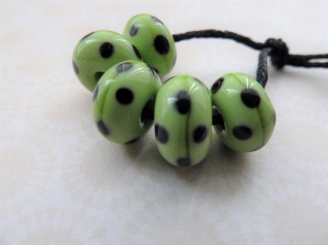 green and black polka dot handmade lampwork glass beads