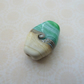 lampwork glass focal bead, green and ivory beach
