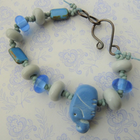 blue elephant lampwork and copper bracelet