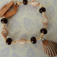 copper, lampwork and ceramic shell bracelet