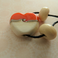 orange and ivory lampwork heart bead