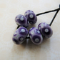 grey and purple lampwork glass beads