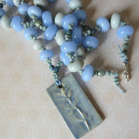 blue and grey glass and ceramic necklace