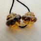 amber ornate lampwork glass bead pair