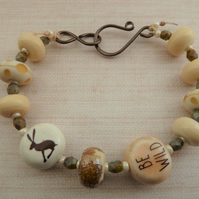 ivory hare bracelet, lampwork glass, copper and ceramic
