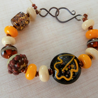 autumn leaves lampwork glass and copper bracelet