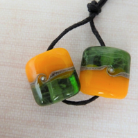 green and yellow lampwork glass bead pair