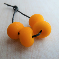 orange tumbled lampwork glass beads
