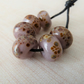 purple frit handmade lampwork glass beads