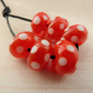 red and white spotty lampwork glass beads