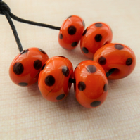 orange and black polka dot lampwork glass beads
