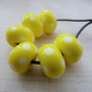yellow and white polka dot lampwork glass beads