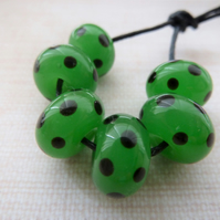 green and black spots lampwork glass beads
