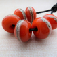 orange wrapped lampwork glass beads