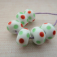 red and green spot lampwork glass beads