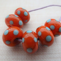 orange and blue polka dot lampwork glass beads