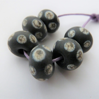 black and ivory spot lampwork glass beads
