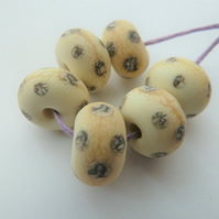 ivory and silvered spot lampwork glass beads