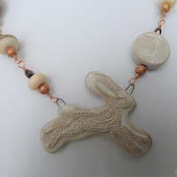 ceramic moon hare necklace, copper and lampwork jewellery