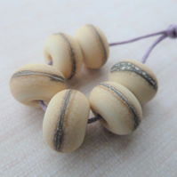 ivory wrapped lampwork glass beads
