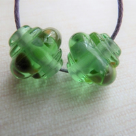 green frit ornate lampwork glass bead pair