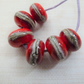 red wrapped lampwork glass beads