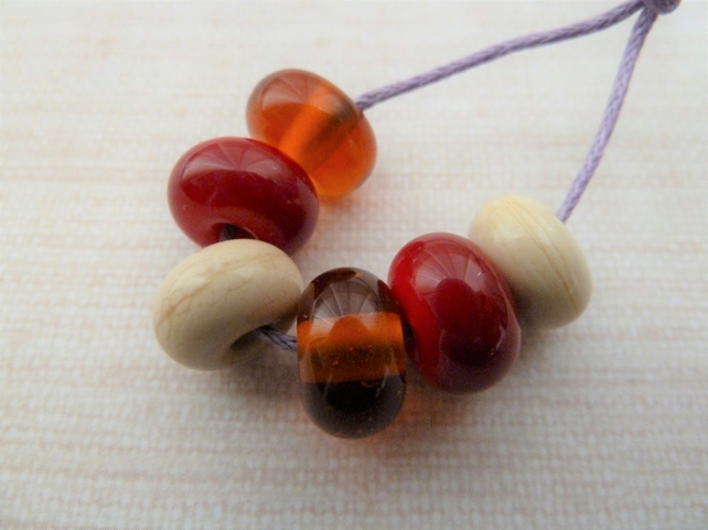 ivory, red and amber lampwork glass spacer beads
