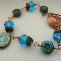 blue bird ceramic, lampwork and copper bracelet
