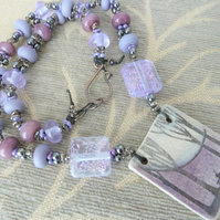 purple lampwork, copper and ceramic hare necklace