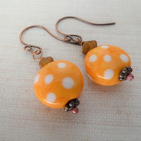 copper and orange lampwork glass earrings