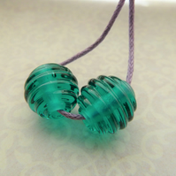 teal ribbed lampwork glass bead pair