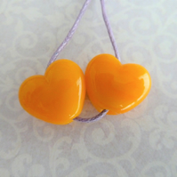 yellow orange lampwork bead heart pair